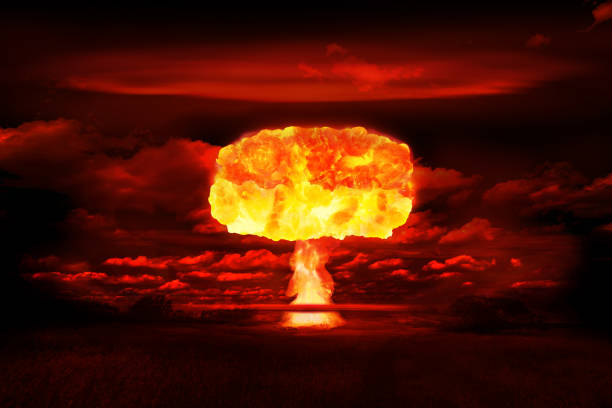 Atomic bomb realistic explosion, red color with smoke on black background stock photo