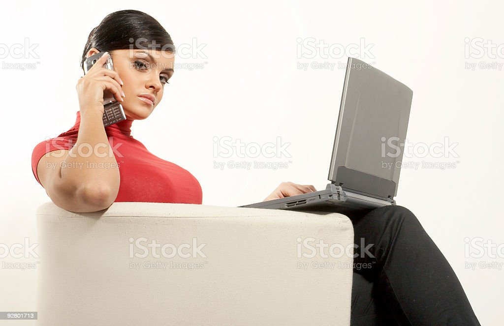 Atractive brunet businesswoman with Laptop and phone royalty-free stock photo