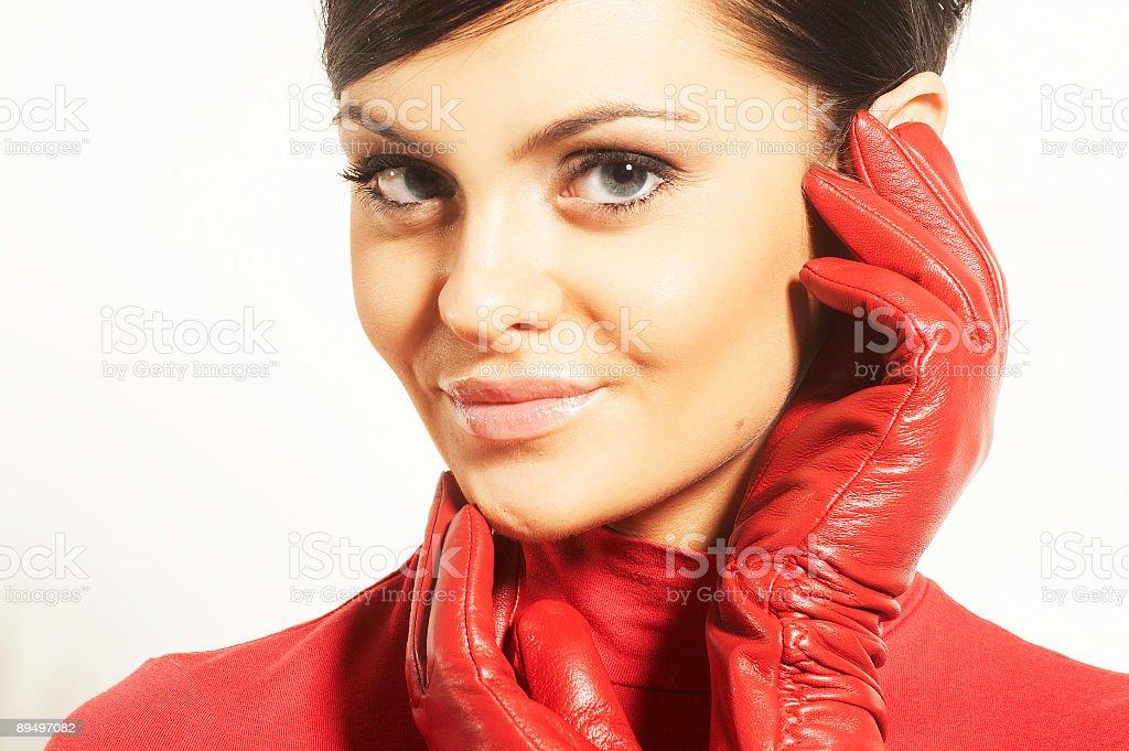 Atractive brunet w red blouse i rękawice zbiór zdjęć royalty-free