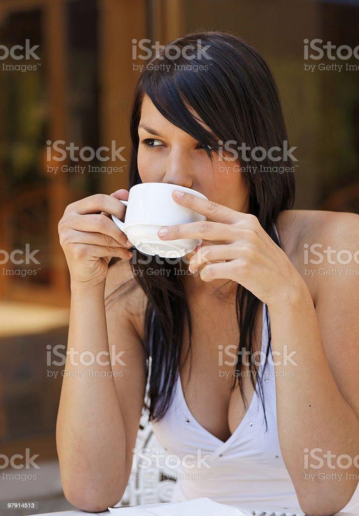atractive girl drinks coffee or tea royalty-free stock photo