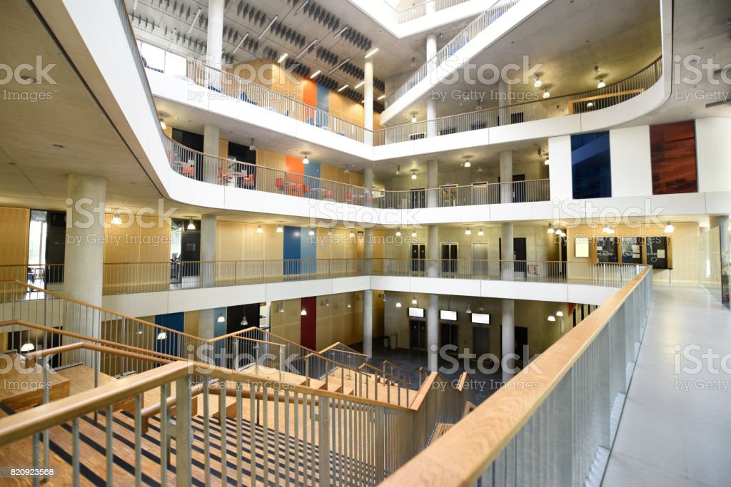 Atrium of large modern college campus building stock photo
