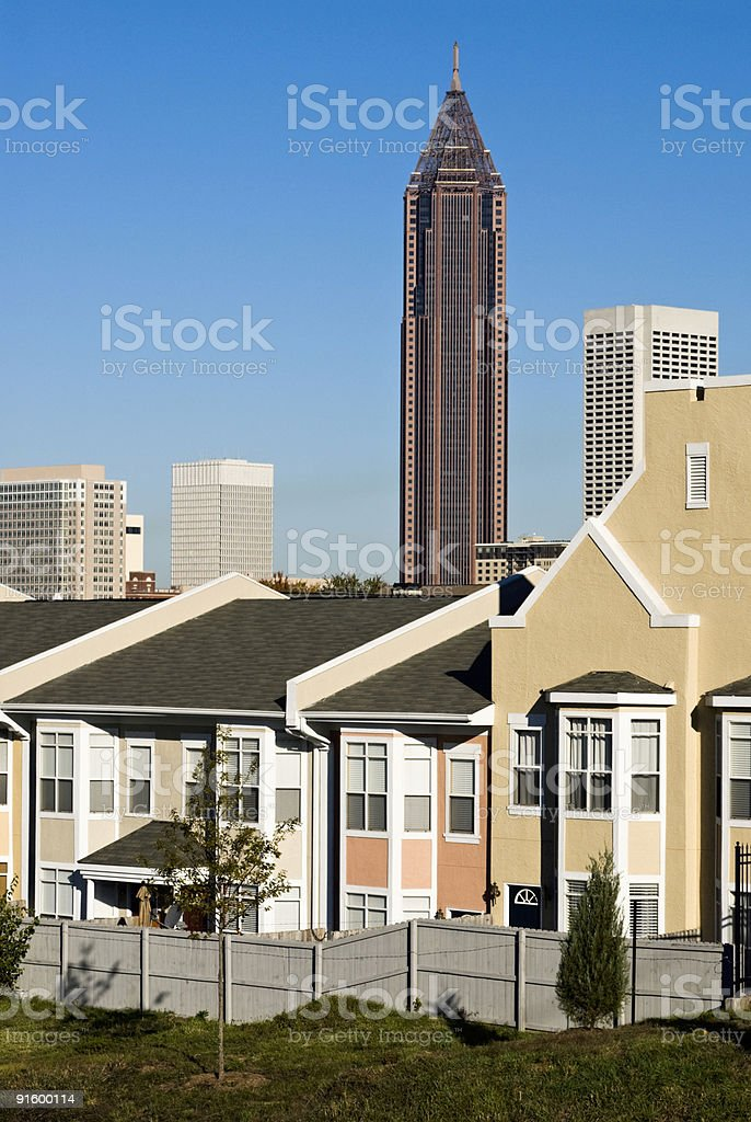 Attached houses with Atlanta Georgia city skyline in the background stock photo