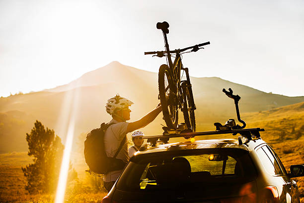 Attaching a Bike to a Roof Carrier on a Car stock photo