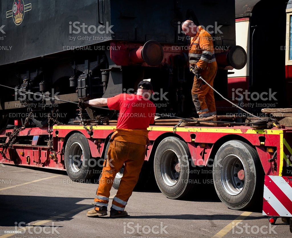 Attaching a winch line to a steam engine tender stock photo