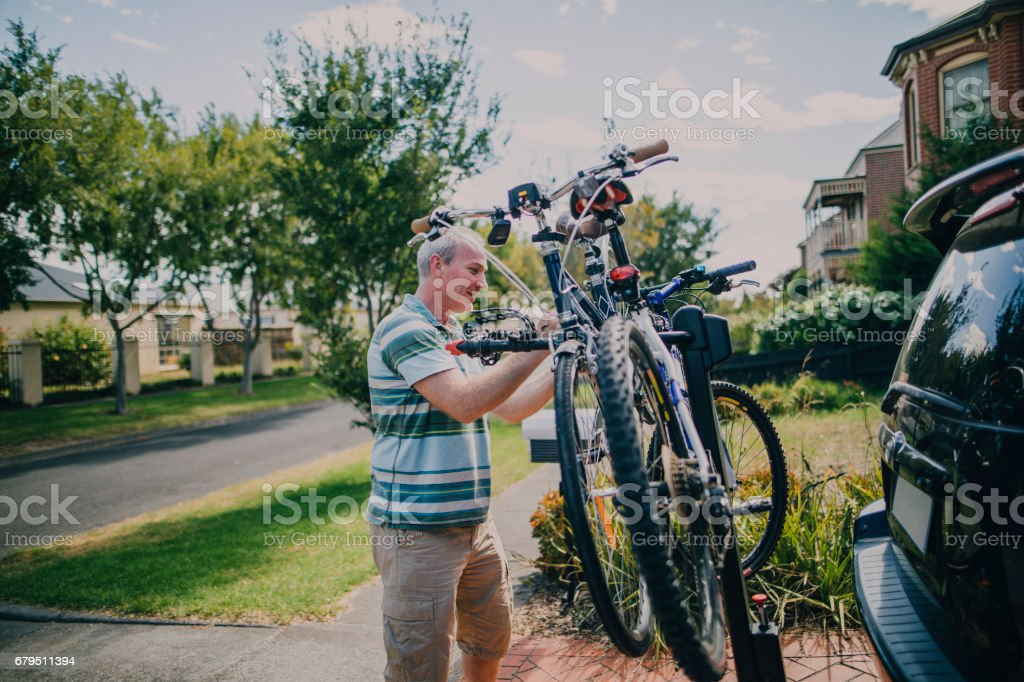 Attaching Bikes to a Bike Rack stock photo