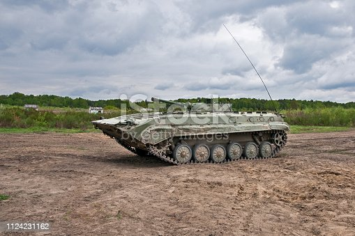 istock attacking infantry fighting vehicle 1124231162