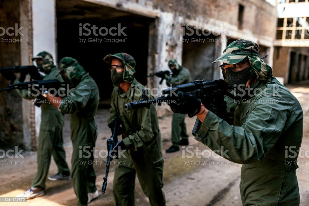 Attacking the enemy and make them surrender stock photo