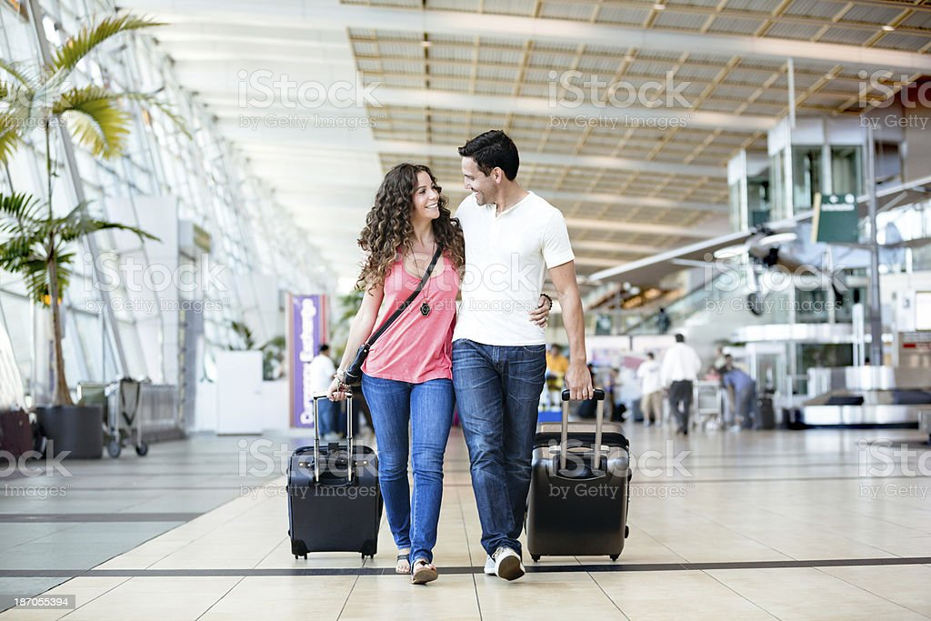 Attactive couple in an airport stock photo