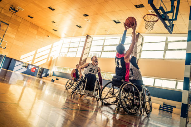 Attempting a block during a wheelchair basketball game