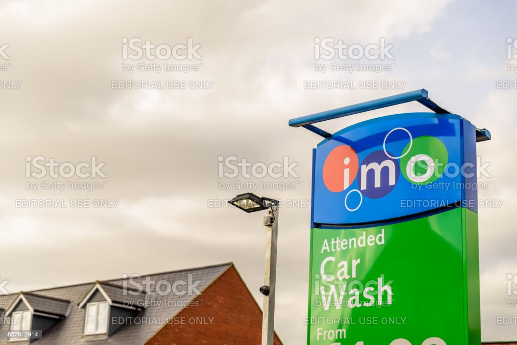 IMO Attended car wash logo sign in Northampton town centre stock photo