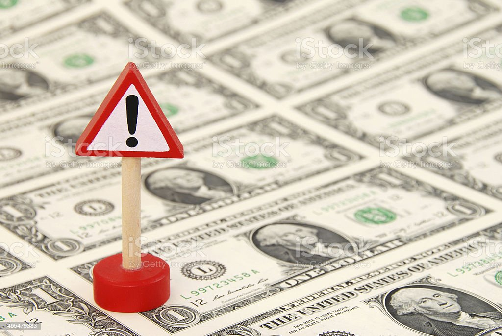 Attention! Black Spot Sign standing on One Dollar Bills stock photo