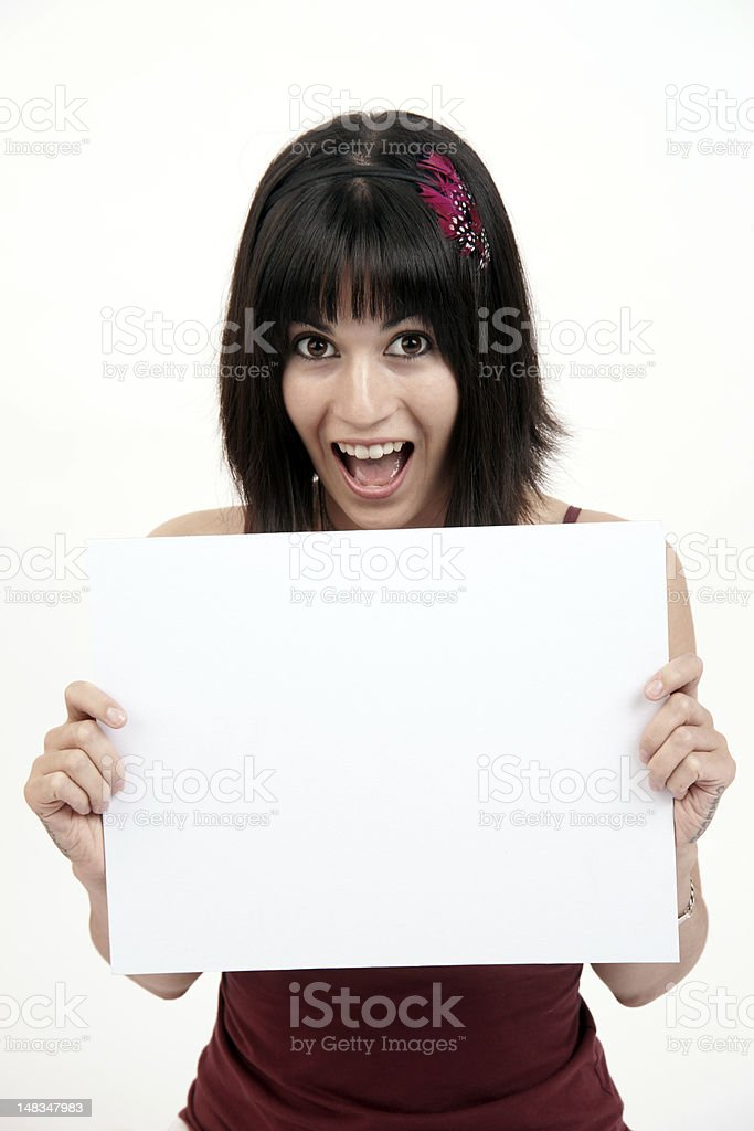 Attention Excited Pretty Woman Holds Up Blank White Sign royalty-free stock photo
