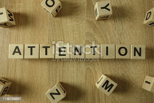 istock Attention word from wooden blocks 1130256301