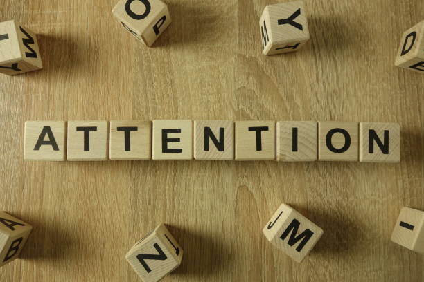 Attention word from wooden blocks stock photo