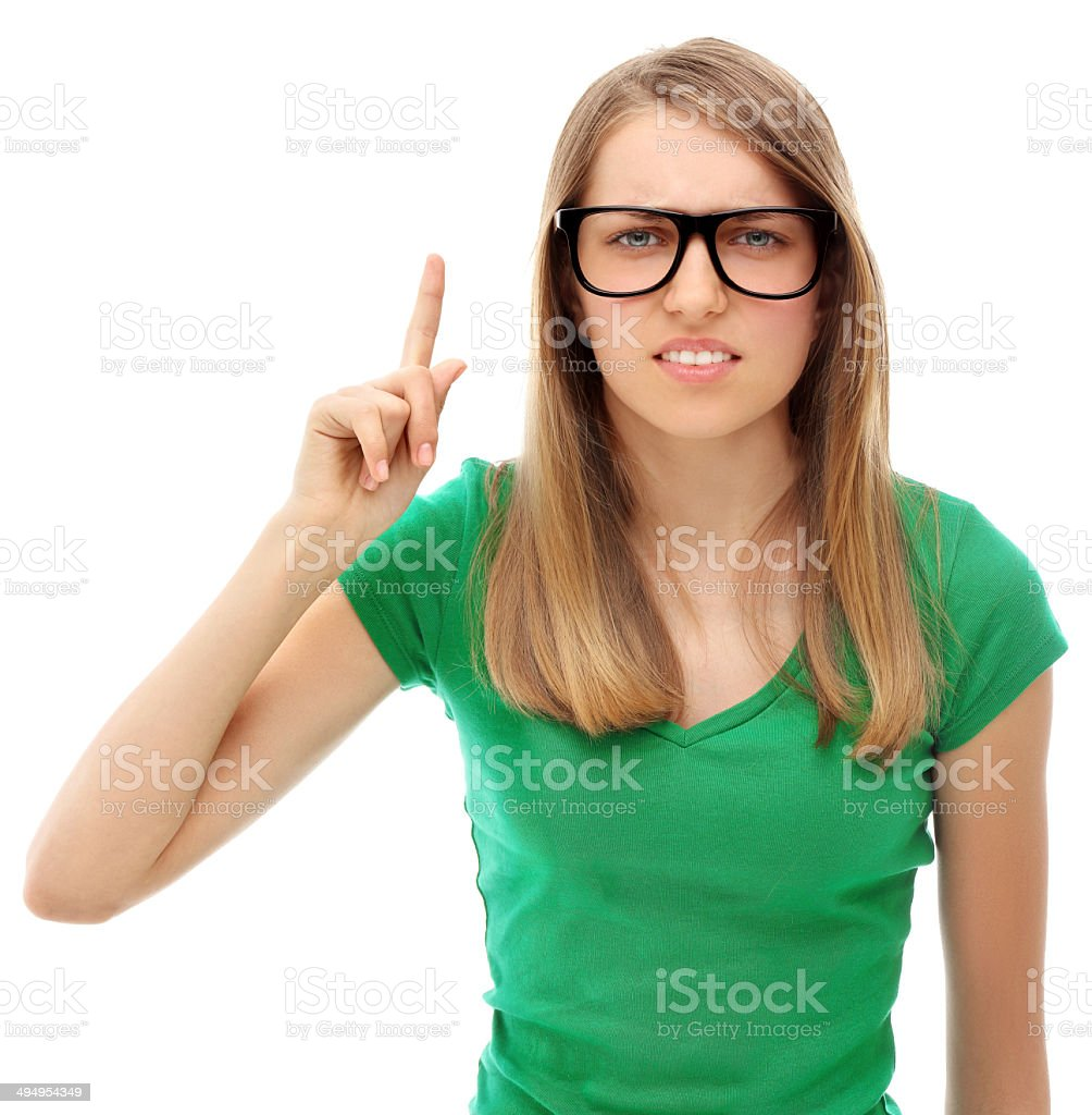 Attention!Portrait of young woman shaking finger.White background stock photo