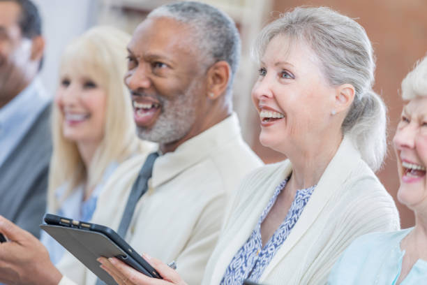Attentive active senior attend continuing education class stock photo