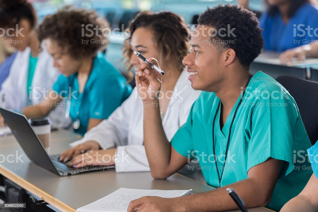 Attentive African American male pre-med student in class stock photo