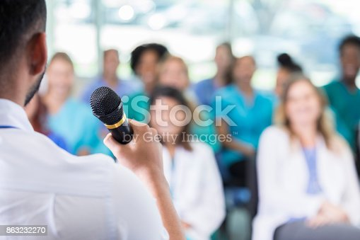 istock Attentive audience of healthcare professionals listen to speaker during conference 863232270