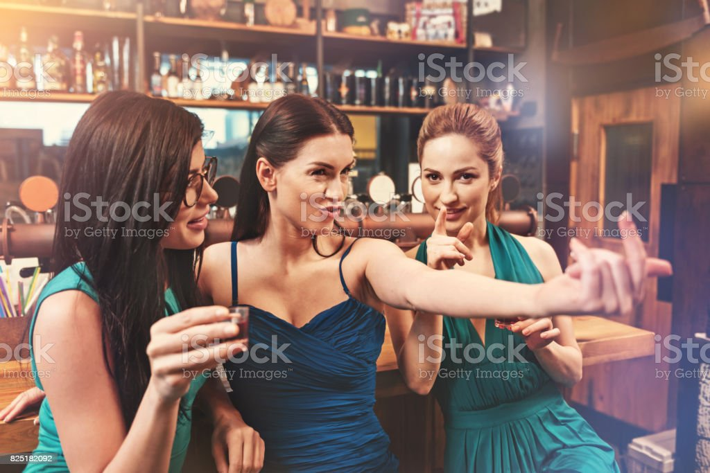 Attentive blonde pointing on camera stock photo
