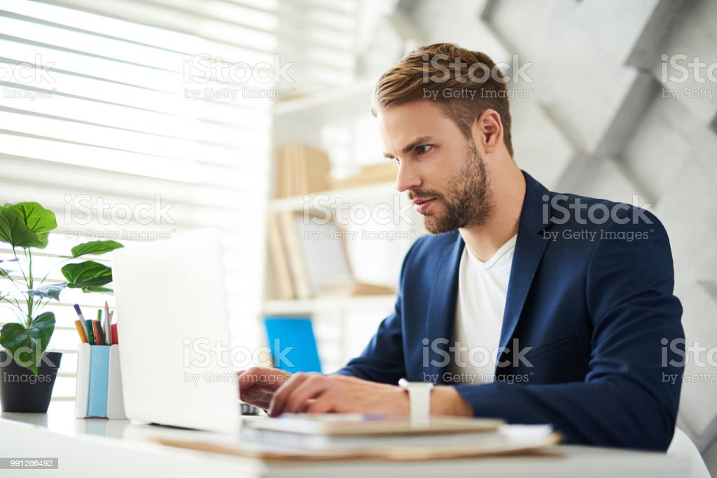 Attentive businessman at computer in office stock photo