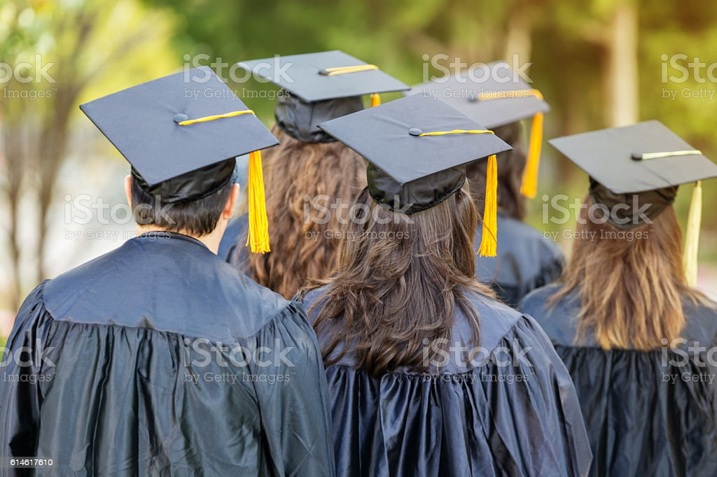 Attentive college students during graduation stock photo