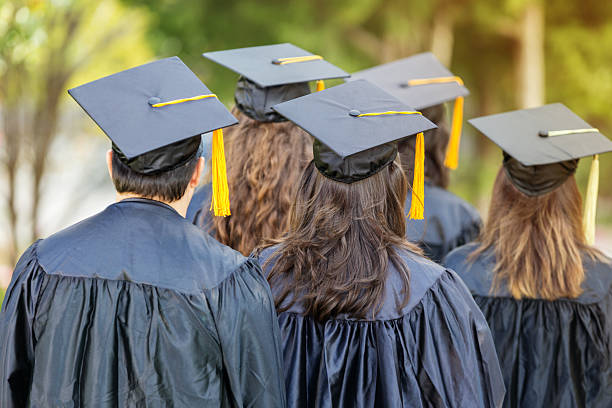 attentive college students during graduation - row of heads stock photos and pictures