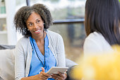 istock Attentive counselor listens to patient 1026754390