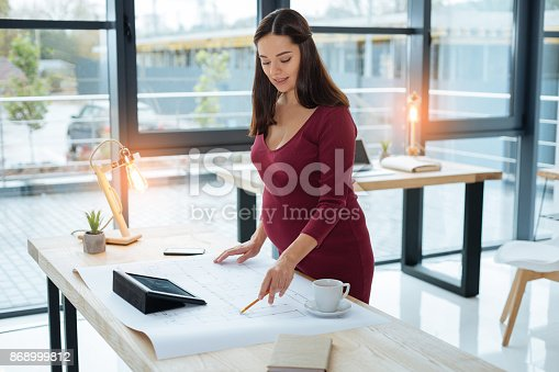 istock Attentive engineer working on new sketch 868999812