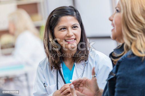 istock Attentive female doctor listens to patient 696620228