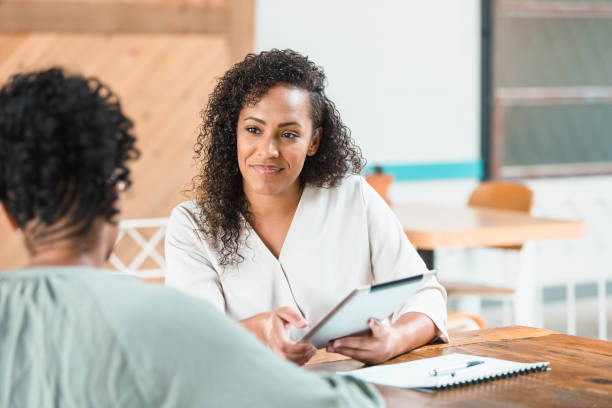 Attentive financial advisor meets with client stock photo