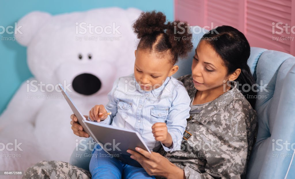 attentive intelligent w checking daughters essay stock photo  attentive intelligent w checking daughters essay royalty stock photo
