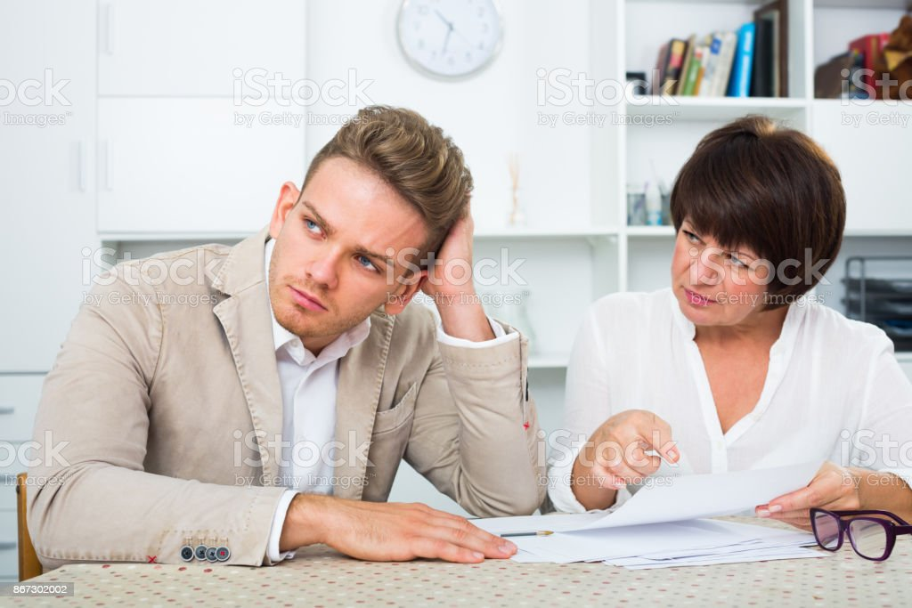 Attentive man consults at the familiar lawyer stock photo