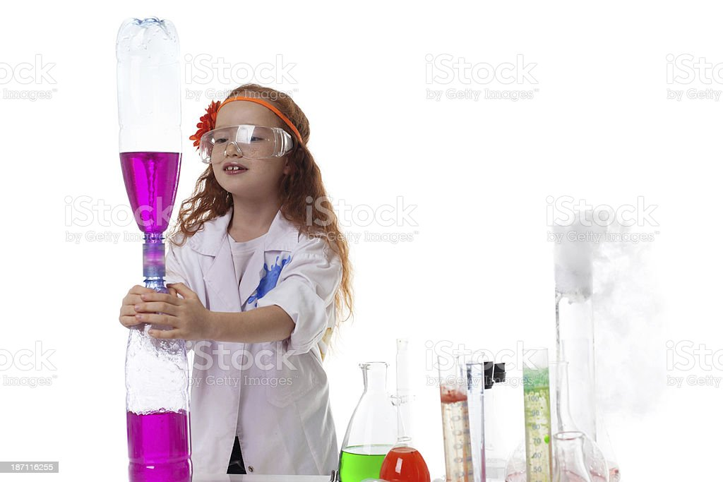 Attentive schoolgirl conducting experiment royalty-free stock photo