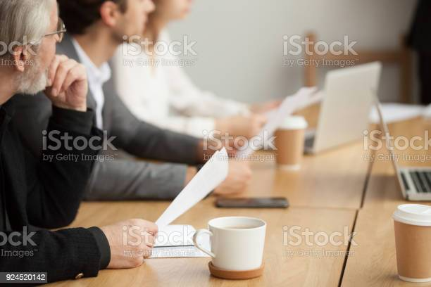 Attentive senior businessman focused on listening at group meeting picture id924520142?b=1&k=6&m=924520142&s=612x612&h=ohd17z b i8qdbdlpekigsxmzyem19hkyn9wl0nt7um=
