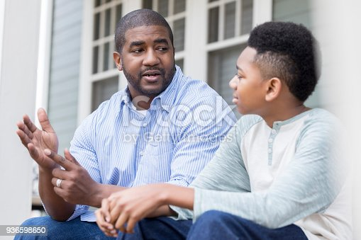 istock Attentive son listening to his dad's advice 936598650