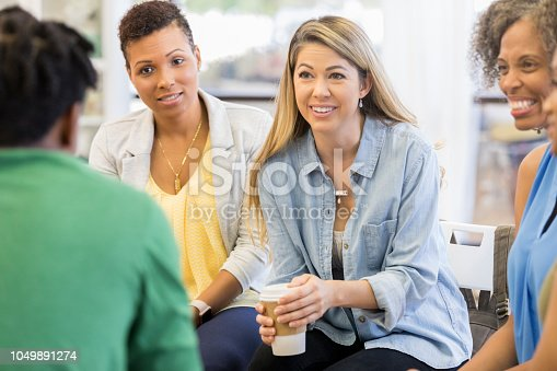 istock Attentive woman during group counseling session 1049891274