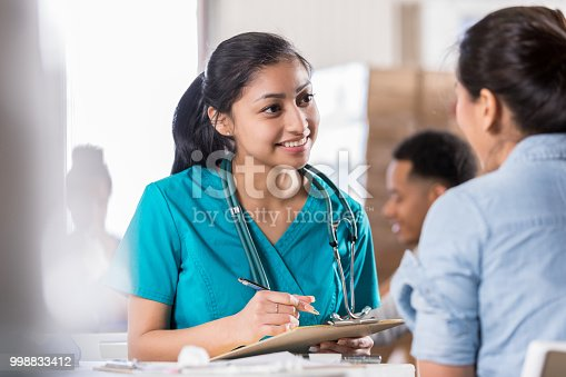 istock Attentive young doctor talks with female patient 998833412