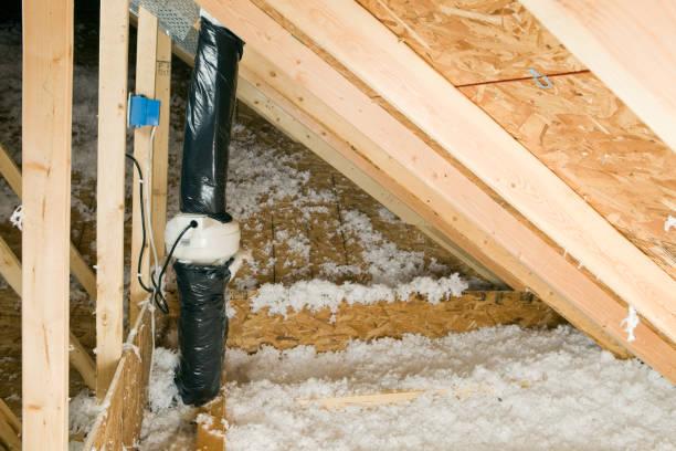 attic radon vent fan with roof trusses and insulation - radon test stockfoto's en -beelden