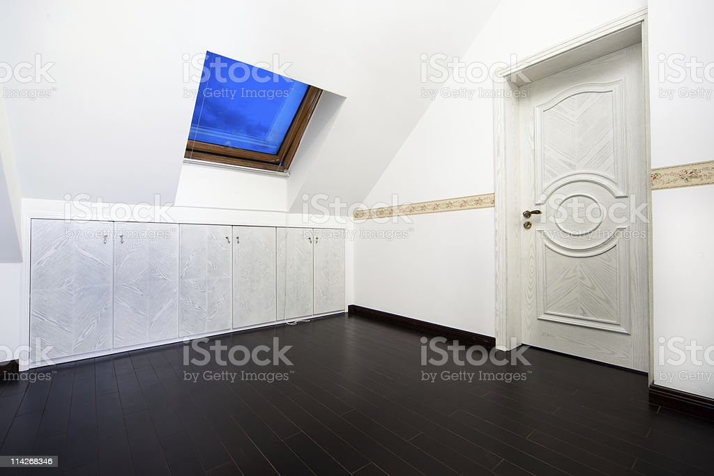 Attic room with roof skylight window royalty-free stock photo