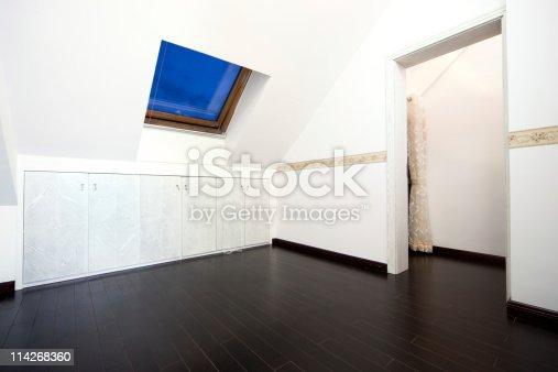 istock Attic room with roof skylight window 114268360