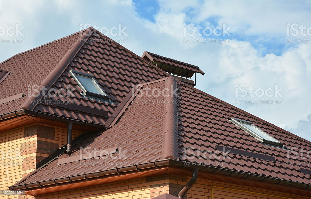 Attic skylights, gutter system, roof windows and roof protection stock photo