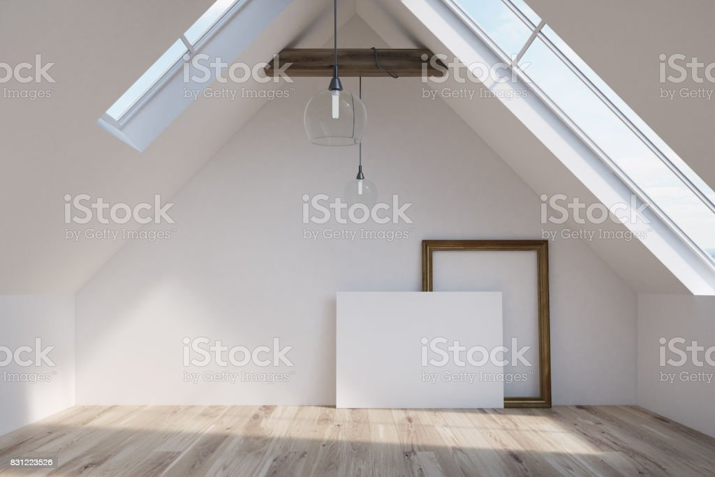 Attic with a blank poster and a frame stock photo