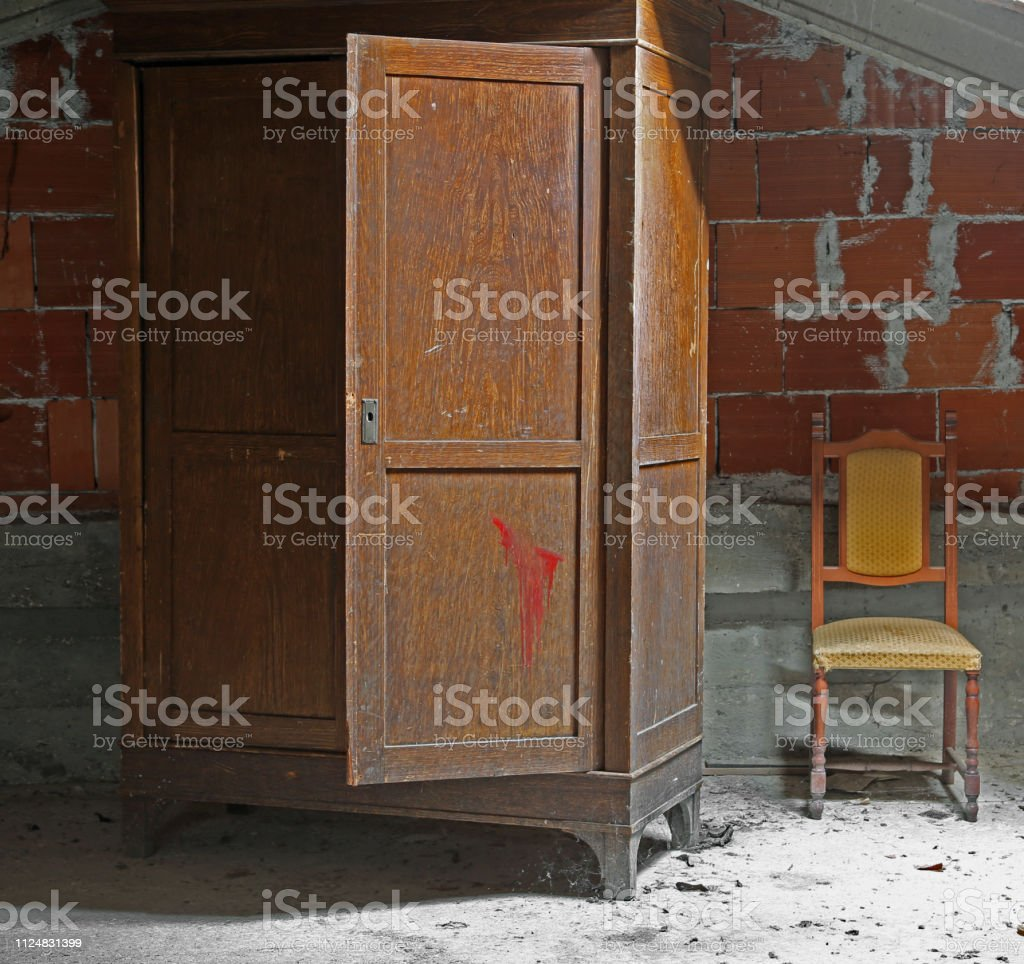 Attic With An Old Wooden Wardrobe And An Old Chair Stock