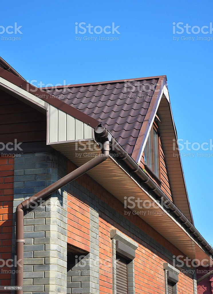 Attic with rain gutter and downspout pipe. stock photo