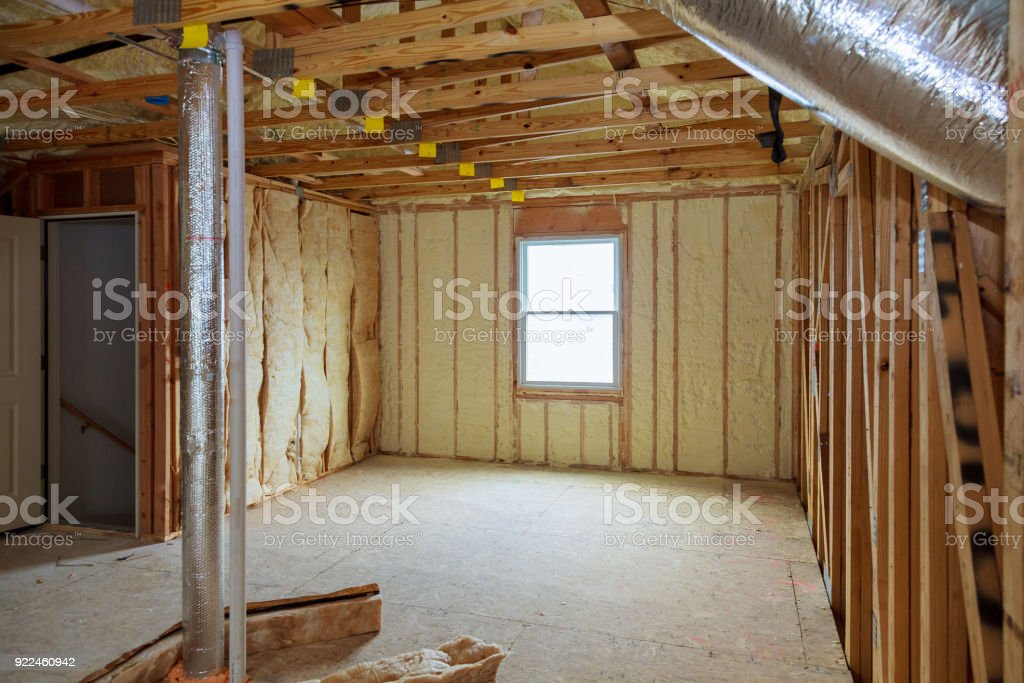 Attick loft insulation partly isolated wall stock photo