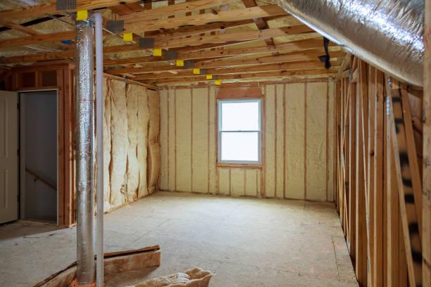 Attick loft insulation partly isolated wall stock photo