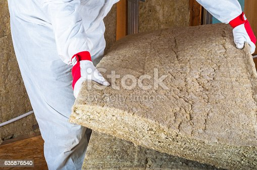 Attick loft insulation man taking roc-wool plate