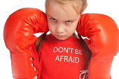 """""""Cute little girl with attitude wearing red boxing gloves, looking very tough"""""""