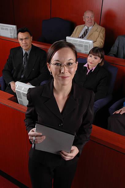 attorney in front of jury box - four lawyers stockfoto's en -beelden