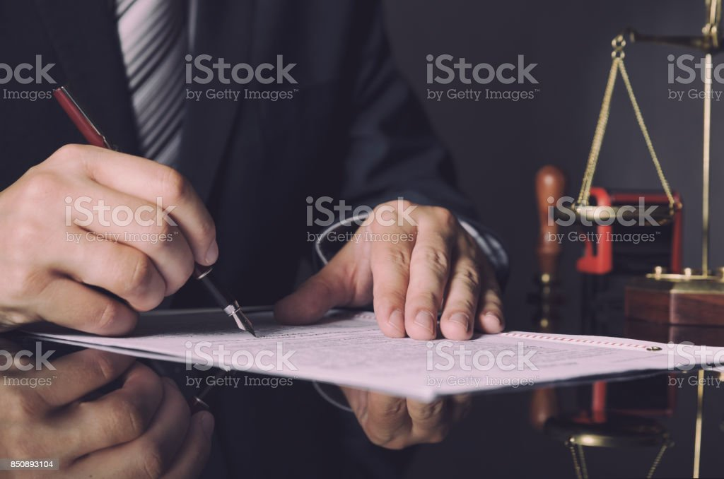 Attorney in suit working in office stock photo